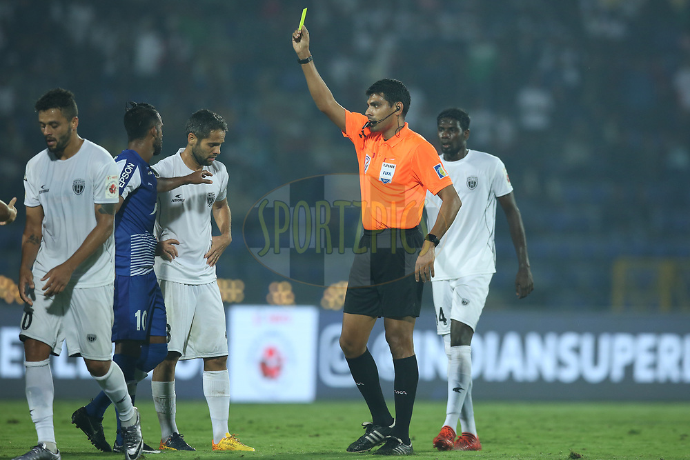 Harmanjot Singh Khabra of Bengaluru FC receives a yellow card from the referee during match 19 of the Hero Indian Super League between NorthEast United FC and Bengaluru FC held at the Indira Gandhi Athletic Stadium, Guwahati India on the 8th December 2017<br /> <br /> Photo by: Deepak Malik  / ISL / SPORTZPICS