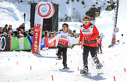 17.03.2017, Ramsau am Dachstein, AUT, Special Olympics 2017, Wintergames, Schneeschuhlauf, Divisioning 100 m, im Bild Nok Io Choi (MAC), BIB 212, Eojin Kim (KOR) // during the Snowshoeing Divisioning 100 m at the Special Olympics World Winter Games Austria 2017 in Ramsau am Dachstein, Austria on 2017/03/17. EXPA Pictures © 2017, PhotoCredit: EXPA / Martin Huber