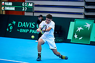 Sopot, Poland - 2018 April 08: Kamil Majchrzak from Poland plays while Men's Single Match Nr 4 during Poland v Zimbabwe Tie Group 2, Europe/Africa Second Round of Davis Cup by BNP Paribas at 100 years of Sopot Hall on April 08, 2018 in Sopot, Poland.<br /> <br /> Mandatory credit:<br /> Photo by © Adam Nurkiewicz / Mediasport<br /> <br /> Adam Nurkiewicz declares that he has no rights to the image of people at the photographs of his authorship.<br /> <br /> Picture also available in RAW (NEF) or TIFF format on special request.<br /> <br /> Any editorial, commercial or promotional use requires written permission from the author of image.