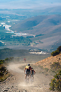 VILLIERSDORP, SOUTH AFRICA - riders descend down towards the Riviersonderend valley during stage three of the Absa Cape Epic Mountain Bike Stage Race held between Villiersdorp and Greyton on the 24 March 2009 in the Western Cape, South Africa..Photo by Gary Perkin /SPORTZPICS