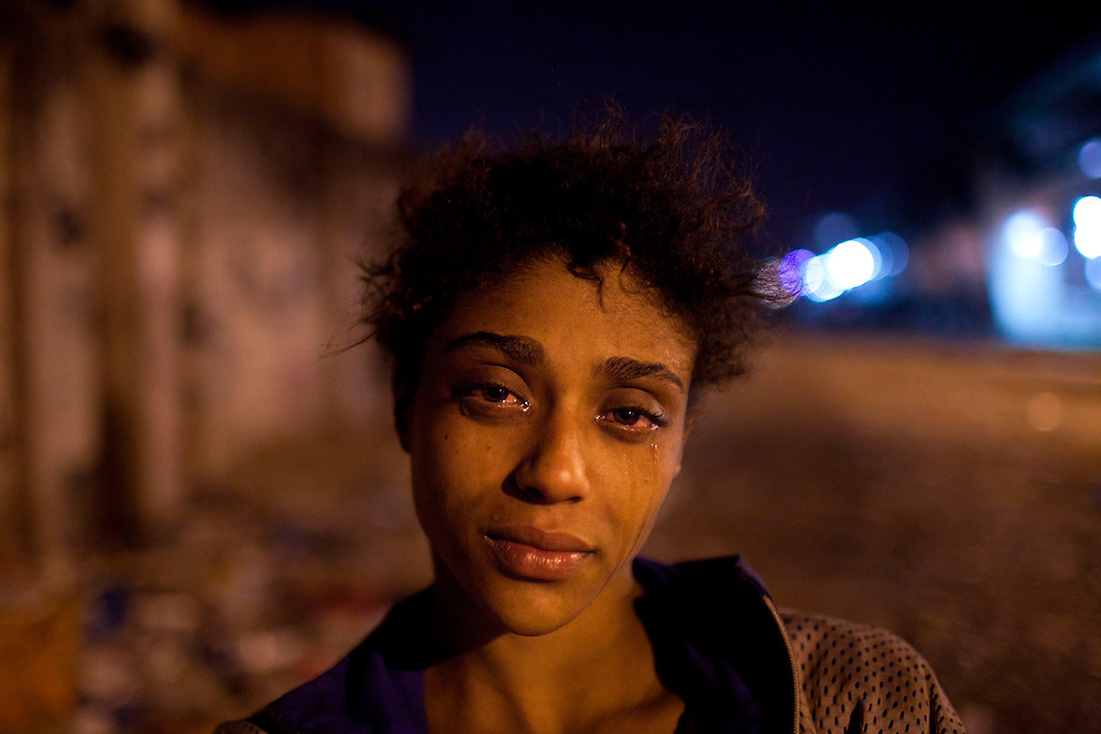 In this Aug. 7, 2012 photo, Natalia Gonzales, a 15-year-old crack user, poses for a portrait in an area known as &quot;Crackland&quot; in the Manguinhos slum in Rio de Janeiro, Brazil. <br /> <br />  The South American country began experiencing a public health emergency in recent years as demand for crack boomed and open-air &quot;cracolandias,&quot; or crack lands, popped up in the sprawling urban centers of Rio and Sao Paulo, with hundreds of users gathering to smoke the drug. The federal government announced in early 2012 that more than $2 billion would be spent to fight the epidemic, with the money spent to train local health care workers, purchase thousands of hospital and shelter beds for emergency treatment, and create transitional centers for recovering users.