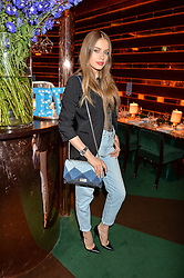 XENIA TCHOUMITCHEVA at a dinner hosted by Roger Vivier to celebrate The Prismick Denim by Camillle Seydoux held at Casa Cruz, 123 Clarendon Road, London on 17th March 2016.