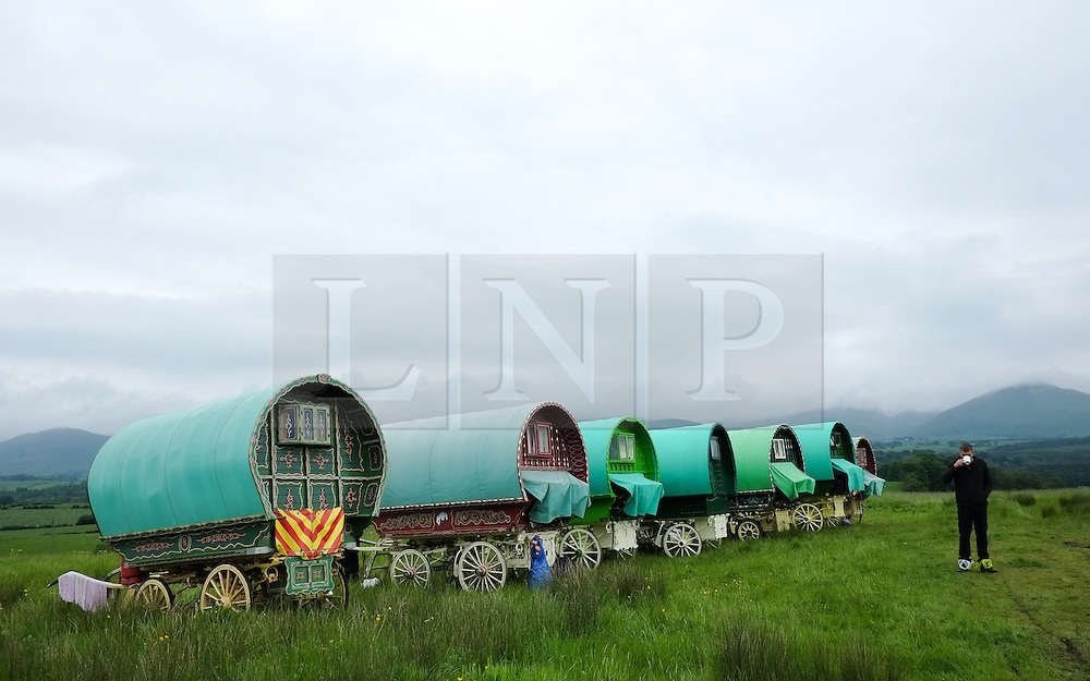 © Licensed to London News Pictures. <br /> 05/06/2014. <br /> <br /> Appleby, Cumbria, England<br /> <br /> Bow top wagons line up as as gypsies and travellers gather during the annual horse fair on 5 June, 2014 in Appleby, Cumbria. The event remains one of the largest and oldest events in Europe and gives the opportunity for travelling communities to meet friends, celebrate their music, folklore and to buy and sell horses.<br /> <br /> The event has existed under the protection of a charter granted by King James II in 1685 and it remains the most important event in the gypsy and traveller calendar.<br /> <br /> Photo credit : Ian Forsyth/LNP