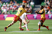 Jonny Lomax of England kicks infront of Nene Macdonald of Papua New Guinea to score a try during the Rugby League World Cup Quarter-Final match between England and  Papua New Guinea at Melbourne Rectangular Stadium, Melbourne, Australia on 19 November 2017. Photo by Mark  Witte.