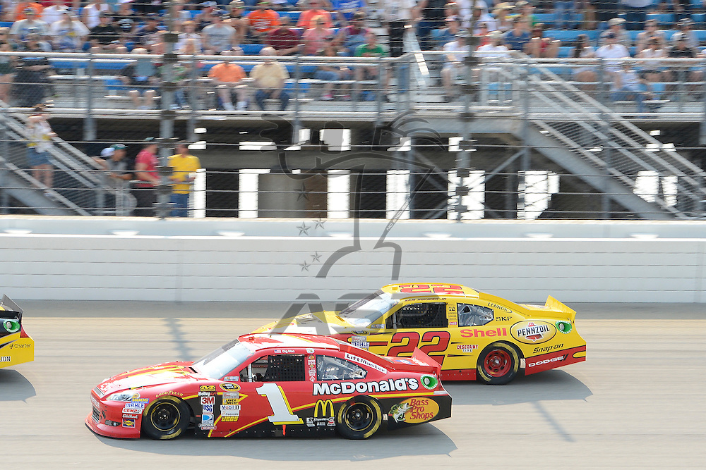 Joliet, IL - SEP 16, 2012: Jamie McMurray (1) races side by side with Sam Hornish Jr. (22) during the Geico 400 at the Chicagoland Speedway in Joliet, IL.