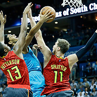 01 November 2015: Charlotte Hornets guard Jeremy Lamb (3) goes for the layup against Atlanta Hawks guard Lamar Patterson (13) and Atlanta Hawks forward Tiago Splitter (11) during the Atlanta Hawks 94-92 victory over the Charlotte Hornets, at the Time Warner Cable Arena, in Charlotte, North Carolina, USA.