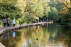 People enjoying the autumn sun in Endcliffe Park Sheffield<br />