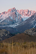 Alpenglow touches snow dusted peaks of the eastern Sierra, Bishop, CA