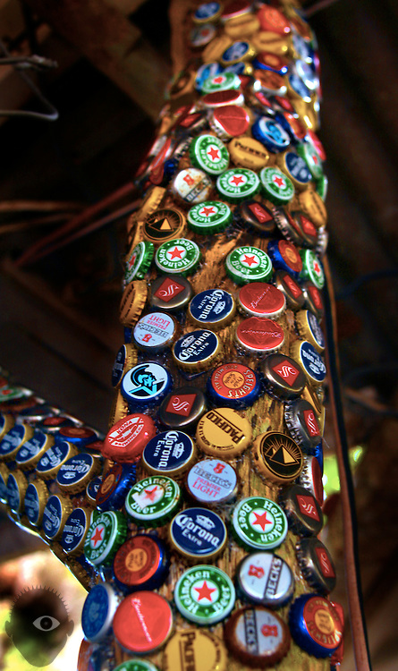Bottle caps line wooden posts at Uncle Robert's 'Awa Bar in Kalapana on the Big Island, Hawaii.