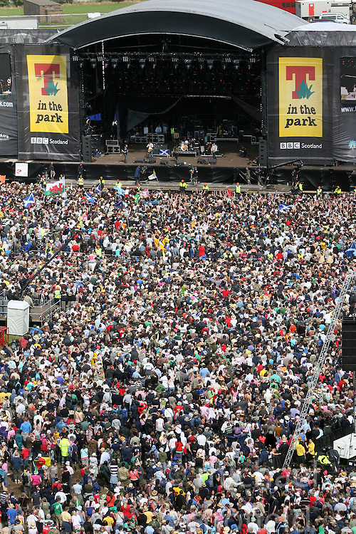 Paolo Nutini plays on the Main stage, as seen from the ferris wheel, T in the Park, Sunday 8 July 2007..T in the Park festival took place on the 6th, 7th and 8 July 2007, at Balado, near Kinross in Perth and Kinross, Scotland. This was the first time the festival had been held over three days..Pic ©Michael Schofield. All Rights Reserved..