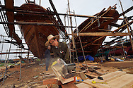 Shipyard for building and renovation traditional wooden fishing boats, in the fishing harbour of Wai Luo Gang, Guangdong province, China