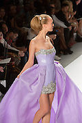 Strapless mini-dress with satin ball-gown train. By Zang Toi, shown at his Spring 20132 Fashion Week show in New York.