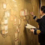 A manequin of a military officer updating one of the large wall maps in the Map Room at the Churchill War Rooms in London. The museum, one of five branches of the Imerial War Museums, preserves the World War II underground command bunker used by British Prime Minister Winston Churchill. Its cramped quarters were constructed from a converting a storage basement in the Treasury Building in Whitehall, London. Being underground, and under an unusually sturdy building, the Cabinet War Rooms were afforded some protection from the bombs falling above during the Blitz.