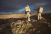 - Hanksville, Utah, U.S. - <br /> <br /> Life On Mars<br /> <br /> The Mars Society operates simulated Mars Missions here on Earth to teach scientists how to live and work on another planet, and is is dedicated to encouraging the exploration and settlement of Mars. This six-person international crew included engineers, and a biologist all doing their own research in relative isolation in a Mars environment. For two weeks, they traded earthly conveniences for scientific progress. They imposed a delay of roughly 20 minutes on e-mails to simulate the communication delay from the Red planet to Earth. When they ventured outside their cylindrical 'hab' or habitat, they had to wait in an airlock for 5 minutes of 'decompression' and don bulky simulated spacesuits &ntilde; complete with boots, ski gloves, and bubble like perspex helmets. With the US space agency currently building spacecraft able to take humans to the Moon, Mars and possibly beyond - Space colonization is no longer the fodder of science fiction, it is becoming a reality.<br /> <br /> The Mars Society is dedicated to encouraging the exploration and settlement of Mars. Founded by Robert Zubrin and others in mid-1998, the Purpose of the Mars Society is to 'further the goal of the exploration and settlement of the Red Planet.' The organization is dedicated to convincing the public and governments of the benefits of Mars exploration, as well as exploring the possibilities of private Mars missions. Mars Analog Research Stations are laboratories for learning how to live and work on another planet. The Utah Mars Desert Research Station hosts teams of geologists, astrobiologists, engineers, mechanics, physicians and others in relative isolation in a Mars environment.The six-person international crew including civil and electrical engineers, and a biologist all doing their own research. For two weeks, they traded earthly conveniences for scientific progress. They imposed a delay of roughly 20 minutes on e-mails to simulate the communication delay from the R