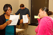 (from left) Christie Haney of Miamisburg, David Lobo of Dayton and Lakiya Davis during vision screenings at the 10th Annual Celebrating life & health free community health fair at Sinclair's Ponitz Center in downtown Dayton, Saturday, April 21, 2012. More than 50 vendors were spread over three floors providing vision, hearing, blood pressure and other screenings, health information and entertainment.
