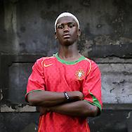 """Nuno Ricardo Ramos Carlota, 18, Lissabon, Portugal, hat mit seiner Familie in einem illegalen Slum am Rande Lissabons gelebt, bis der vor sieben Monaten abgerissen wurde und sie in eine Sozialwohnung umgesiedelt wurden. Er braucht 300 Euro zum Leben im Monat..""""Ich will Fußballprofi werden. Wenn das nicht klappt, möchte ich eine einfache Arbeit, bei der man nicht viel nachdenken muss, bei McDonald's oder so.""""..Nuno Ricardo Ramos Carlote, age 18, Lissabon, Portugal. Lived in an illegal slum on the outskirts of Lissabon with his family, until it was demolished seven months ago and they were relocated to a welfare housing project. He needs 300 Euro per month to make his living..""""I want to become a soccer professional. If that doesn't work, I want a simple job where I don't have to think very much, at McDonald's for example."""""""