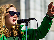 "15 MARCH 2019 - ST. PAUL, MINNESOTA, USA: Anna Grace Hottinger, 16, from Shoreview, MN, an organizer Minnesota Climate Strike, speaks during the ""Climate Strike"" at the Minnesota State Capitol in St. Paul, MN. Thousands of high school students braved below freezing temperatures and biting winds to demand action on climate change. The Minnesota Climate Strike was inspired by the strike by Greta Thunberg, a Swedish high school student, who started a climate strike at her school in August 2018.        PHOTO BY JACK KURTZ"