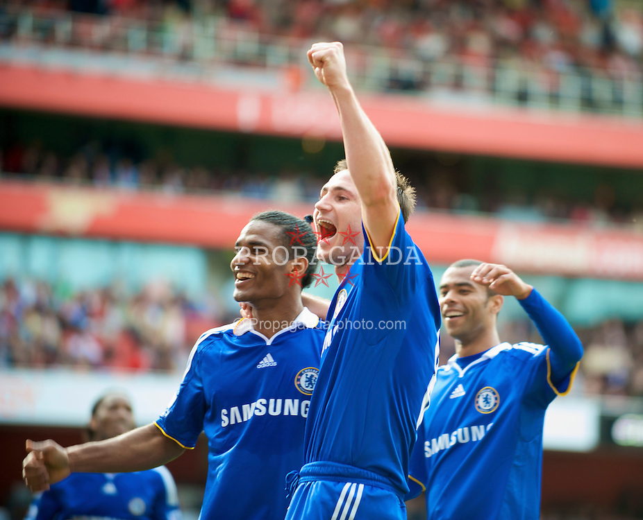 LONDON, ENGLAND - Sunday, May 10, 2009: Chelsea's Florent Malouda celebrates scoring the fourth goal against Arsenal with team-mate Frank Lampard during the Premiership match at the Emirates Stadium. (Photo by David Rawcliffe/Propaganda)