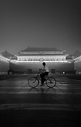 A cyclist passes the main gate of the Forbidden City, the former residence of Chinese Emperors in the center of Beijing.