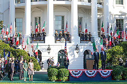 October 18, 2016 - Washington, DC, United States - On the South Lawn  of the White House in Washington, D.C., U.S., on Tuesday, Oct. 18, 2016., Italian Prime Minister Matteo Renzi, and President Barack Obama, stand at attention onstage, during the ceremony at the Official State Visit. This was the last Official State Visit for the Obama administration. (Credit Image: © Cheriss May/NurPhoto via ZUMA Press)