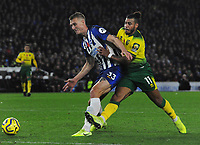 Football - 2019 / 2020 Premier League - Brighton & Hove Albion vs. Norwich City<br /> <br /> Onel Hernandez of Norwich and Dan Burn of Brighton, at The Amex.<br /> <br /> COLORSPORT/ANDREW COWIE