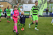 The Silent Child star Maisie Sly walks out with Forest Green Rovers Lee Collins(5) during the EFL Sky Bet League 2 match between Forest Green Rovers and Mansfield Town at the New Lawn, Forest Green, United Kingdom on 24 March 2018. Picture by Shane Healey.