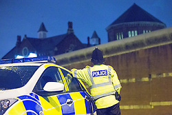 © Licensed to London News Pictures . 15/09/2015 . Manchester , UK . Police watch as a drone , operated by Greater Manchester Fire and Rescue and equipped with thermal imaging systems , is used to find prison protester Stuart Horner amongst the rooftops of HMP Manchester , shortly before dawn this morning (15th September 2015) . Photo credit: Joel Goodman/LNP