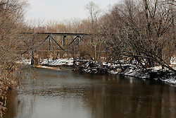 29 February 2008:   an old iron bridge used for rail traffic spans the Mackinaw River near Goodfield Illinois in the winter.