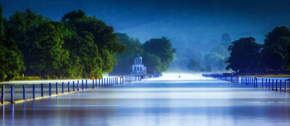 Solitary Rower cuts through the early mornin mist