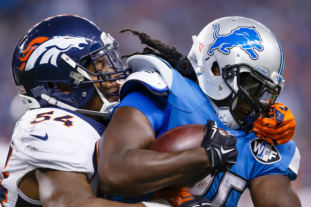 Detroit Lions running back Joique Bell (35) is tackled by Denver Broncos inside linebacker Brandon Marshall (54) during an NFL football game at Ford Field in Detroit, Sunday, Sept. 27, 2015. (AP Photo/Rick Osentoski)