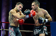 Nick Pace(lLeft) barely holds on to his mouth piece after Niko Tsigaras(Right) lands a hard right hook at battle at the Capitale at the Capitale theater in New York City on September 27, 2013