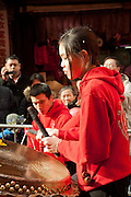 A young woman drummer from New York's Hung Sing Kwoon martial arts and lion dance organization.