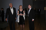 Sir Evelyn de Rothschild and Lord  and Lady Andrew Lloyd Webber. Turner Whistler Monet, exhibtion opening dinner, Tate Britain. 7 February 2005, ONE TIME USE ONLY - DO NOT ARCHIVE  © Copyright Photograph by Dafydd Jones 66 Stockwell Park Rd. London SW9 0DA Tel 020 7733 0108 www.dafjones.com
