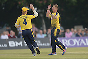 Hampshire all-rounder Gareth Andrew and Hampshire batsman Jimmy Adams celebrate during the NatWest T20 Blast South Group match between Middlesex County Cricket Club and Hampshire County Cricket Club at Uxbridge Cricket Ground, Uxbridge, United Kingdom on 27 May 2016. Photo by David Vokes.