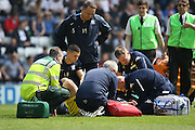 Both medical teams assist Leeds United defender, Liam Cooper (6) after a clash of heads with Joe Garner during the Sky Bet Championship match between Preston North End and Leeds United at Deepdale, Preston, England on 7 May 2016. Photo by Pete Burns.
