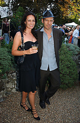 PAUL & TRICIA SIMONON at a party to celebrate Stephen Jones's 25 Years of Millinery held at Debenham House, 8 Addison Road, London W14 on 13th July 2006.<br /><br />NON EXCLUSIVE - WORLD RIGHTS