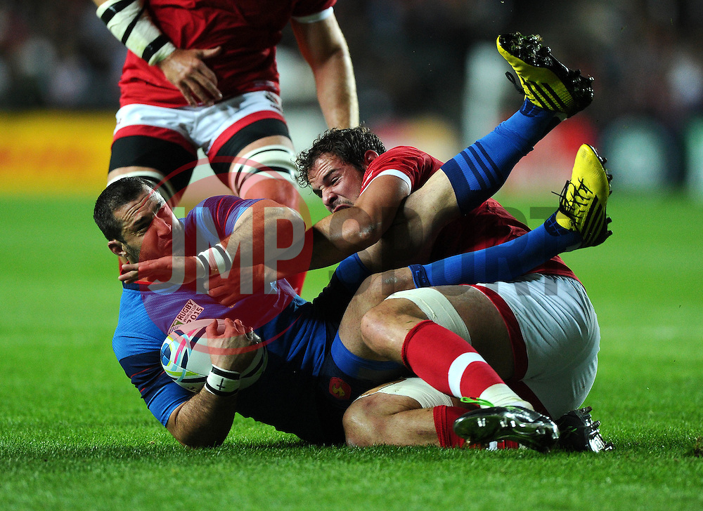 Tyler Ardron (c) of Canada tackles Scott Spedding of France  - Mandatory byline: Joe Meredith/JMP - 07966386802 - 01/10/2015 - Rugby Union, World Cup - Stadium:MK -Milton Keynes,England - France v Canada - Rugby World Cup 2015