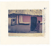Oromo child runs out of her home which has been painted. Southern Ethiopia<br />