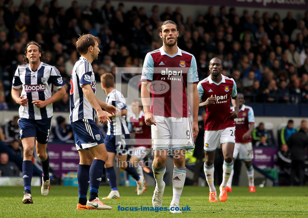Andy Carroll (centre) of West Ham United stands dejected during the Barclays Premier League match at The Hawthorns, West Bromwich<br /> Picture by Tom Smith/Focus Images Ltd 07545141164<br /> 26/04/2014