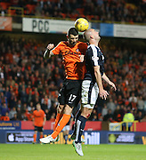 Dundee's James McPake in aerial battle against United's Mark Durnan - Dundee United v Dundee at Tannadice<br /> - Ladbrokes Premiership<br /> <br />  - &copy; David Young - www.davidyoungphoto.co.uk - email: davidyoungphoto@gmail.com