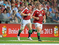 1 June 2013; Cian Healy, left, and Matt Stevens, British & Irish Lions, come onto the pitch as second half substitutes. British & Irish Lions Tour 2013, Barbarians v British & Irish Lions, Hong Kong Stadium, So Kon Poh, Hong Kong, China. Picture credit: Stephen McCarthy / SPORTSFILE