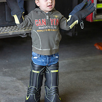 Quinn Berry from Shannon tries on firemans boots and gloves
