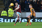 Burnley defender Michael Duff clears ball forward away from Hull City midfielder Sam Clucas  during the Sky Bet Championship match between Hull City and Burnley at the KC Stadium, Kingston upon Hull, England on 26 December 2015. Photo by Ian Lyall.
