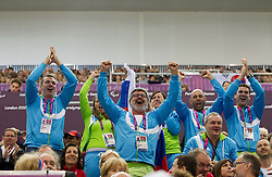 Supporters of Slovenia celebrate after Francek Gorazd Tirsek of Slovenia won second place during the Men's R4-10m Air Rifle Standing shooting Final during Day 5 of the Summer Paralympic Games London 2012 on September 2, 2012, in Royal Artillery Barracks, London, Great Britain. (Photo by Vid Ponikvar / Sportida.com)