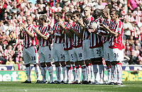 Stoke City v Burnley Premier League Britannia Stadium 15/08/09 Stoke City players durind one minute applause for Sir Bobby Robson. Photo Patrick McCann/Fotosports International