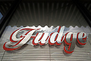 A hand-painted 'Fudge' sign in a candy store window. Missoula Photographer