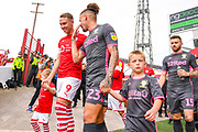 Leeds United midfielder Kalvin Phillips (23) and Barnsley forward Cauley Woodrow (9) enter the pitch during the EFL Sky Bet Championship match between Barnsley and Leeds United at Oakwell, Barnsley, England on 15 September 2019.