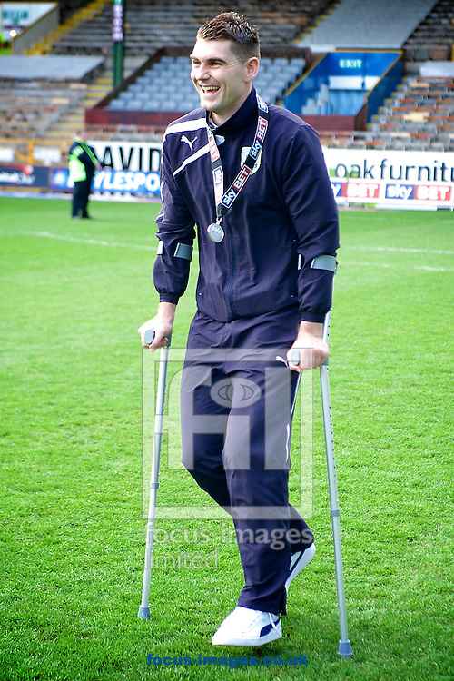 Injured Burnley player Sam Vokes with his medal following the Sky Bet Championship match at Turf Moor, Burnley<br /> Picture by Ian Wadkins/Focus Images Ltd +44 7877 568959<br /> 26/04/2014