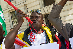 London, April 21st 2015. A small group of human rights protesters demonstrate outside South Africa's embassy in Trafalgar Square, against the xenophobic attacks on immigrants from other African countries, by unemployed South Africans.