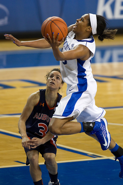 UK guard Bria Goss, right, drives to the basket with pressure from Auburn guard Najat Ouardad in the second half. The University of Kentucky Women hosted Auburn University, Sunday, Jan. 20, 2013 at Memorial Coliseum in Lexington. Photo by Jonathan Palmer